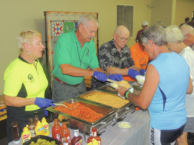 Submitted photos Food is critical to fueling a successful distance cycling ride as GCP&T Trail Sentinels spent the week volunteering with rest stops, SAG support and meals. Shown, left to right, are trail sentinels Marilyn Roberts, Larry Rodney and David Harrison as they help serve one of two catered dinners offered during the event.