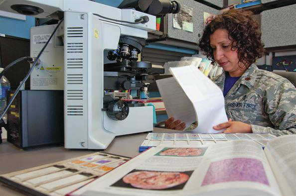 Submitted photos Wright-Patterson Medical Center staff pathologist Maj. Dr. Luisa Watts reviews a patient's file while making a molecular determination of what could be causing the patient's symptoms.