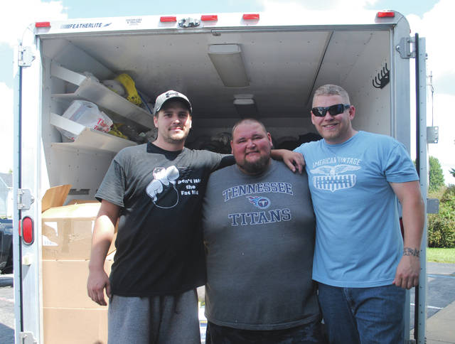 Whitney Vickers | Xenia Gazette Eric Shultz, Shawn Long and Tom Arnett, who collected supplies for hurricane victims and are leaving for Texas to deliver the items and offer sets of helping hands as individuals are still being rescued.