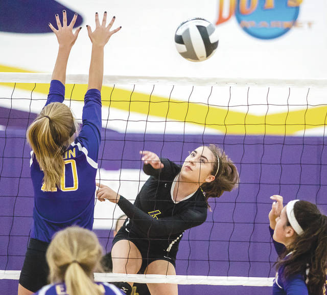 Junior outside hitter Mara Neal (4) hits a shot past an Eaton defender, during the first set of Thursday's Aug. 31 girls volleyball game at Bellbrook High School. Neal and the Golden Eagles swept their Southwestern Buckeye League rivals in three sets.