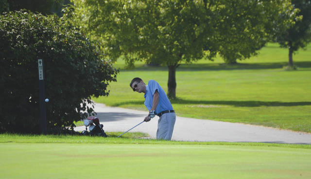 Fairborn's Trey Boedicker chips onto the 10th green, during Wednesday's Aug. 23 high school golf match against Greeneview. The team match was played at Twin Base Golf Club in Fairborn.
