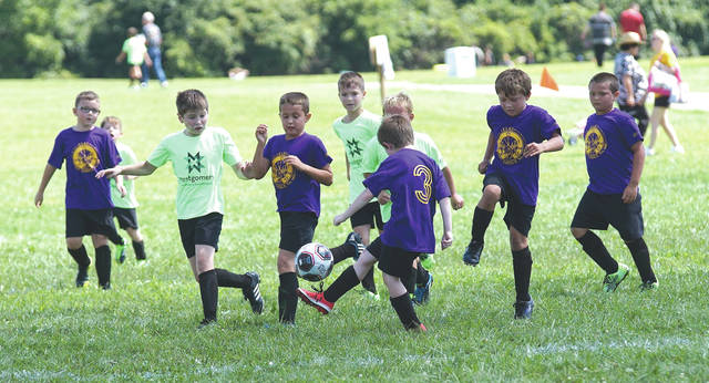 Members of the Montgomery Insurance & Investments-, and Elks Lodge No. 668-sponsored boys youth teams play in a Xenia Soccer Club match, Saturday Aug.12 on the Greene County Fairgrounds fields.