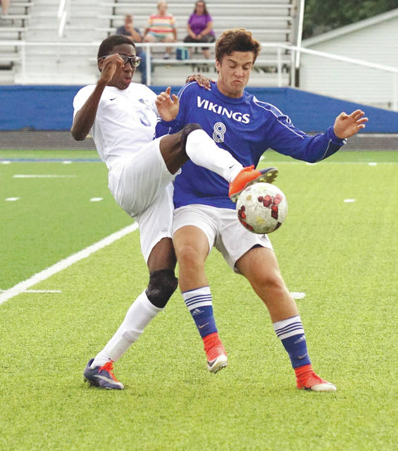 Xenia and Miamisburg players battle for the ball, during a boys high school varsity soccer scrimmage Aug. 14 at Doug Adams Stadium in Xenia. Both teams will begin regular season play on Tuesday Aug. 22.