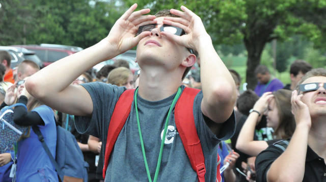 Submitted photo Mathew Flanagan was part of a school-wide science lesson at the Greene County Career Center on the full eclipse Aug. 21. The entire GCCC student body used glasses from Beavercreek City Schools and was able to safely witness the eclipse Monday. Flanagan is a junior from Yellow Springs enrolled in the Digital Media program.