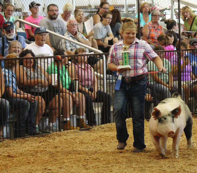 Anna Bolton | Greene County News Danielle Clarkston was surprised when she walked away from the market hog show with a first place trophy.