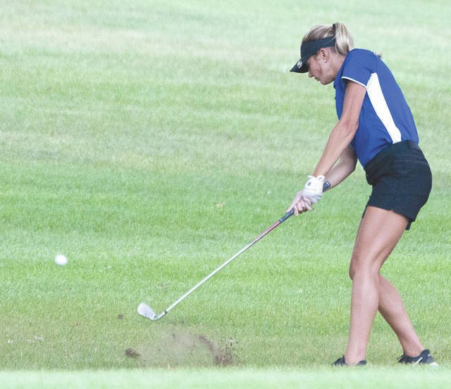 Greeneview senior Frankie Fife smacks a shot out of the rough, during Wednesday's Aug. 30 girls high school golf match with Carroll, at WGC Golf Course in Xenia. Fife led the Rams with a 43 on the WGC back nine.