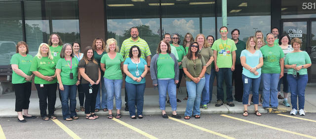 Submitted photo Staff of Greene County Department of Job and Family Services wore green Aug. 2 in honor of Child Support Awareness Day.