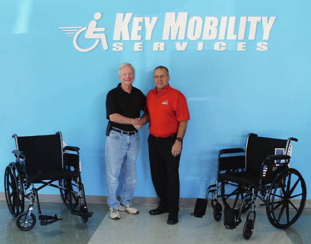 Anna Bolton | Xenia Daily Gazette Al Bailey, Honor Flight Dayton vice president, accepts two new wheelchairs from Cecil Patrick, owner of Key Mobility Services, for veterans participating in Honor Flight.