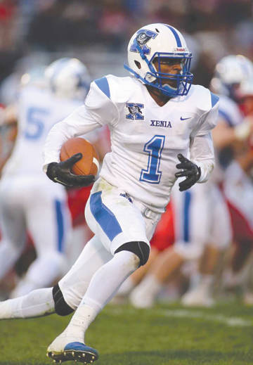 Xenia's Meechi Harris returns an interception against Troy, Aug. 31, at Troy Memorial Stadium.