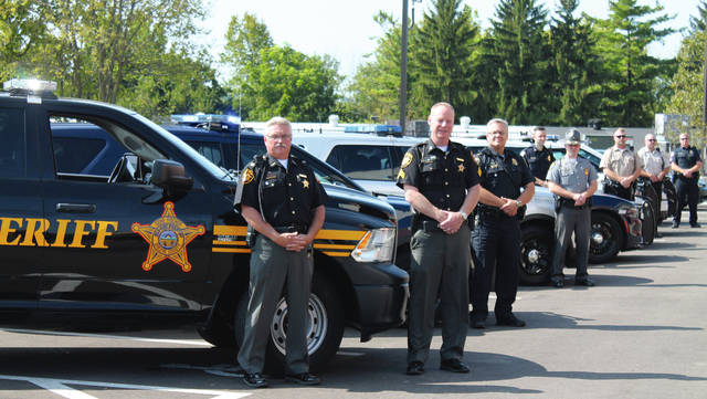 Anna Bolton | Xenia Daily Gazette Local law enforcement officers partnered with Greene County Safe Communities Coalition and AAA to launch the Drive Sober or Get Pulled Over campaign Aug. 24. Pictured are Greene County Sheriff's Mjr. Rick Bowman and Sgt. Shawn Prall, Bellbrook Police Department's Lt. Steve Carmin, Ohio State Highway Patrol Xenia Post Commander Lt. Matt Schmenk, Xenia Police Department's Sgt. Matt Cvitkovich, Greene County Parks & Trails Ranger Lance Geldbaugh and Ranger Doug Mlynarek and Beavercreek Police Department's Sgt. Michael Hummel.