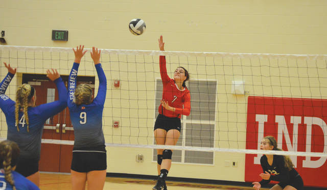 Cedarville's Sara Beste hits around Greeneview defenders Caitlin Sweat (14) and Amanda Mickle (9), during Tuesday's Aug. 22 girls high school volleyball match at Cedarville High. Beste had a game-high 26 kills in the Indians' four-set win.