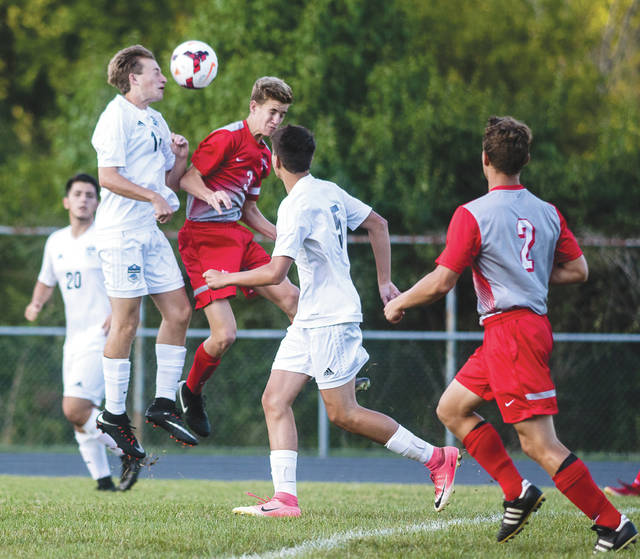 Troy's Connor Hubbell (3) collides with Fairborn's Zane Pacifico (12) while going up to head a ball, during Tuesday's Aug. 29 boys high school varsity soccer match at Fairborn High School. Troy won the contest, 7-0.