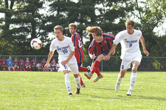 Senior Julian Gundelsweiler (10) and junior Teymour Fultz (8) of the Yellow Springs Bulldogs boys varsity soccer team react to a kick by Liam Ertsgaard (6), as Miami Valley Rams teammate Alec Martin (26) looks on, Aug. 31 in a Metro Buckeye Conference match at Yellow Springs High School. The host Bulldogs won the match, 3-2.