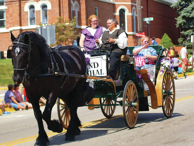 file photos The Cedarfest Labor Day Parade will begin on Main Street at 1 p.m. on Monday, Sept. 4.