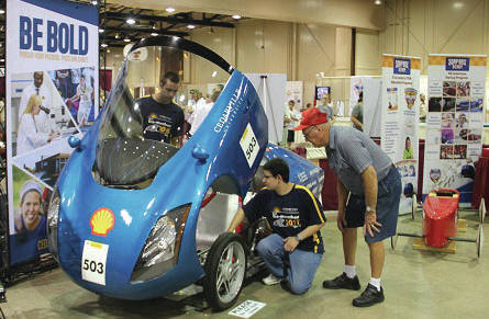 Submitted photo Cedarville engineering students Mark McTaggart (left) and Sam Ellicott show off Cedarville's supermileage car Urbie at the Ohio State Fair Aug. 5. The supermileage and robotics displays earned Best Technology Exhibit honors.