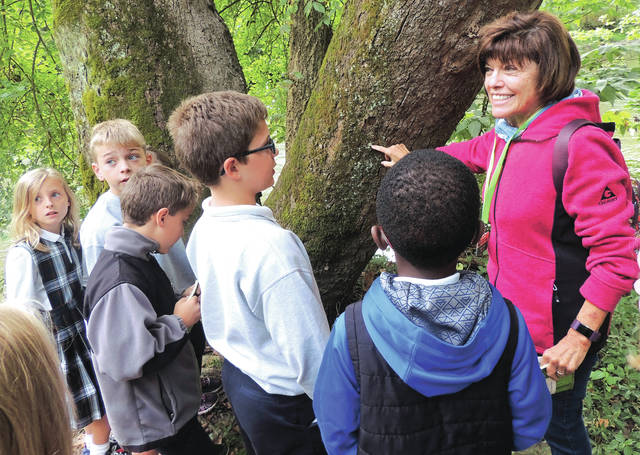 Submitted photos GCP&T volunteer and former teacher Chris Allen shares information on the lichen growing a tree near the river.