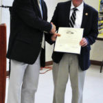 Former director receives proclamation