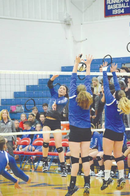 Greeneview's Maddie Hines follows her shot as a pair of Xenia players try to make the block, during the third set of Wednesday's Sept. 13 girls high school volleyball match at Greeneview High School. Hines led the Rams with 10 kills in the three-set win.