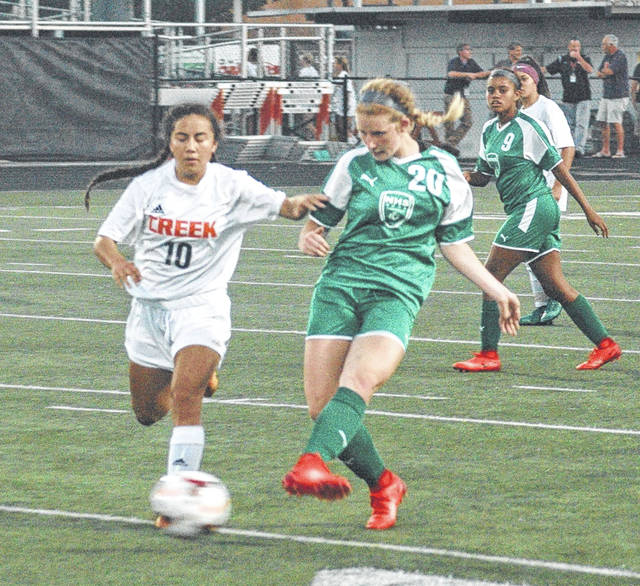 Northmont's Jillian Naas makes a pass past Beavercreek defender Diana Benigno, who later scored the only goal in Wednesday's Sept. 20 girls high school soccer match in Beavercreek.