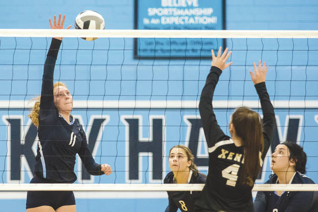 Kayleigh Finlayson (11) delivers a kill for Fairborn, during Tuesday's Sept. 5 Greater Western Ohio Conference match with visiting Xenia. Finlayson led the Skyhawks in kills with 10 in the Fairborn straight-set win.