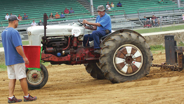 File photos Visitors can watch farm machinery in operation, check out equipment demonstrations, and cheer on tractor pull competitors at Old Timers Days, held Friday-Sunday, Sept. 22-24 at the fairgrounds.