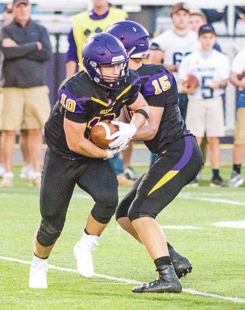 Bellbrook quarterback Brendan Labensky (15) hands off to running back Ethan Savey (10) in last week's high school football game. The Golden Eagles are fourth in their Division III region and remain in the playoff hunt.