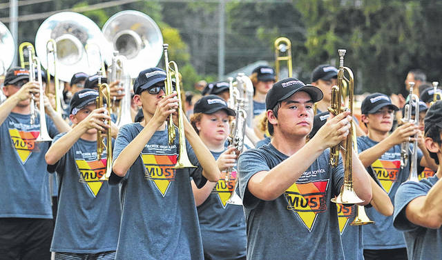 Submitted photos The Beavercreek High School Marching Band performs at recent events. The band will be getting a new look and truck face-lift thanks to a committee of band parents working to raise money for the band.