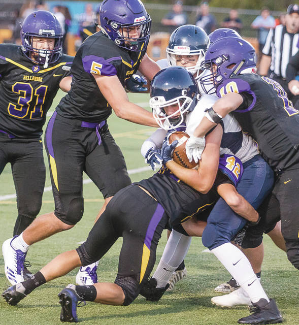 A flock of Golden Eagles tackle a Valley View ball carrier in Bellbrook's home loss, Sept. 29.