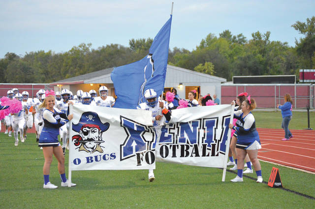 Xenia wide receiver Meechi Harris breaks through the Xenia High School football team banner prior to Friday's Oct. 6 road game with Riverside Stebbins. Xenia won the game to record its first win of the season.