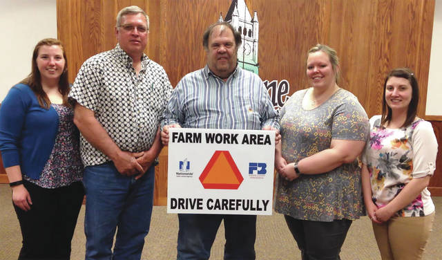 Pictured left to right: Ashley Rose- Ohio Farm Bureau Organizational Director (OD) for Greene, Fayette, Clinton and Warren counties, Joe Krajicek V. President, Dan Jones President, Deana Reed Secretary and former OD for Greene Co. Melinda Lee.