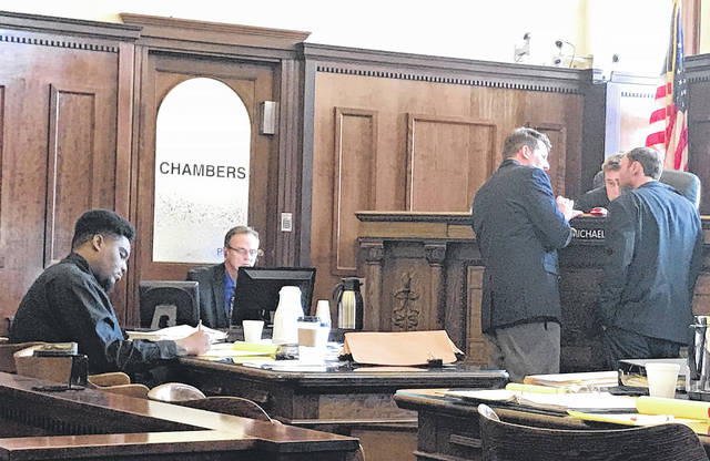 File photo Defendant Jevon Russell (left) takes notes during the August jury trial as assistant prosecutor David Hayes and defense attorney Charles Morrison consult with Judge Michael Buckwalter.
