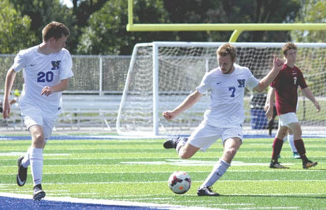 Xenia senior forward Nate Higgins (7) kicks a ball downfield as junior midfielder Nathan Mulikin gives chase, during Saturday's Sept. 30 boys high school soccer match against visiting Urbana. Higgins scored a goal in Xenia's 3-1 win at Doug Adams Stadium.