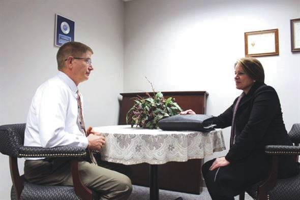 Submitted photo National Background Investigation Bureau Special Agent Josephine Dow meets with Jim Mitchell, 88th Air Base Wing Public Affairs operations chief, to finalize his personnel security investigation. The Air Force currently has more than 90,000 personnel security investigations backlogged.