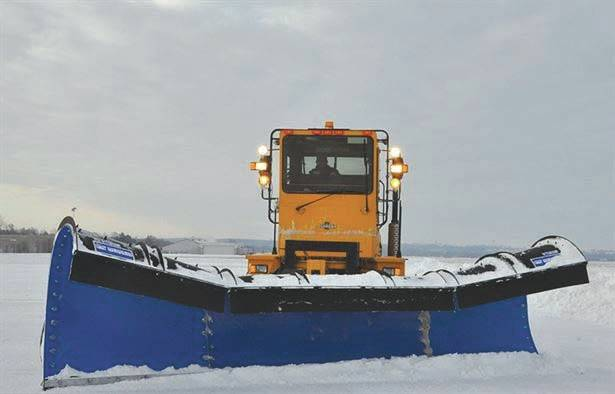 Submitted photo A snow plow clears the runway at Wright-Patterson Air Force Base. Severe weather events like a snow storm can wreak havoc on runways and streets on the installation, causing reporting delays or base closures.