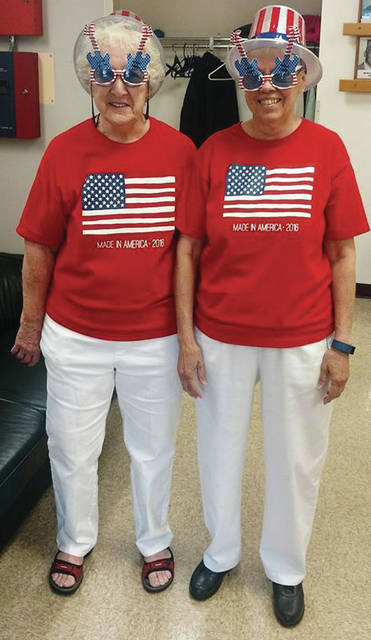 Submitted photo Eileen O'Brien (left) and JoAnne Earley deliver meals for the Xenia senior center every Friday. When there is a holiday, they dress for the occasion.