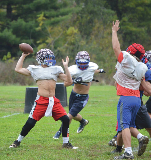 Junior quarterback Nick Clevenger throws a pass during Greeneview's final Thursday practice, before Friday's Nov. 3 high school football playoff game against Cincinnati Hills Christian Academy.