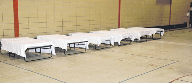 Scott Halasz | Xenia Gazette Several beds are ready for use inside the gym at the former Simon Kenton Elementary School. Bridges of Hope bought the building and is planning on opening a shelter.