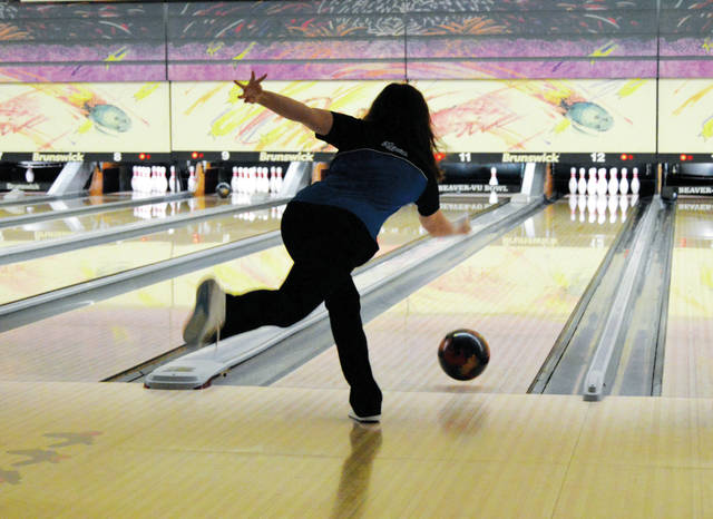 A member of the Xenia girls varsity bowling team throws during an early frame of Thursday's high school bowling match with visiting Miamisburg, Nov. 30 at Beaver-Vu Lanes in Beavercreek.