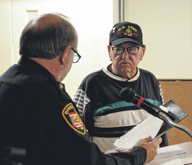 Simon Rose is recognized by Sheriff Gene Fischer during veteran's ceremony.