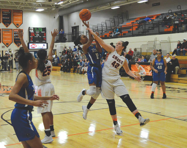 Xenia's Trinity Morton-Nooks (12) puts up a shot against Beavercreek's Haley Hutchins (42), during the first half of Wednesday's Nov. 29 girls high school basketball game in the Ed Zink Fieldhouse at Beavercreek High School.