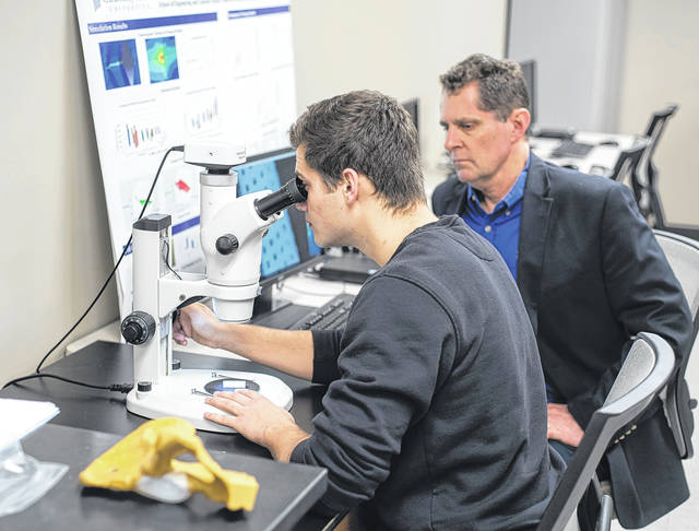 Submitted photo Mitchell Ryan studies human tissue scaffolds in a Cedarville University laboratory with Dr. Tim Norman, professor of mechanical and biomedical engineering.