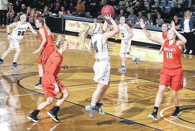 Submitted photo Cedarville University's Baylee Bennett (center) scored a career-high 32 points in a double overtime home loss to the University of Findlay, Dec. 16 at the Callan Athletic Center.