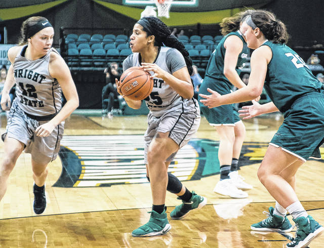 Wright State forward Lexi Smith looks for someone to pass to during first-half action against Green Bay Thursday.