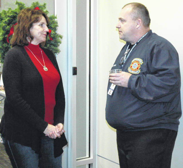 Scott Halasz | Xenia Daily Gazette The City of Xenia had an open house Dec. 19 to recognize and honor Mayor Marsha Bayless and Councilmember Jeanne Mills for their years of service. Neither sought re-election in November. Pictured, Mills and Deputy Fire Chief Joe Mullikin chat.
