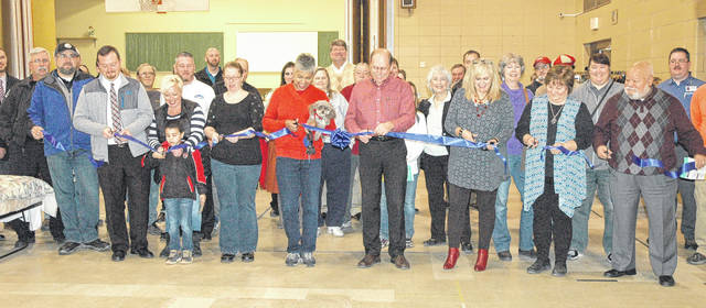 Scott Halasz | Xenia Daily Gazette Members of the Xenia community along with city officials and Bridges of Hope officials cut the ribbon on the new emergency shelter that opened Dec. 18.