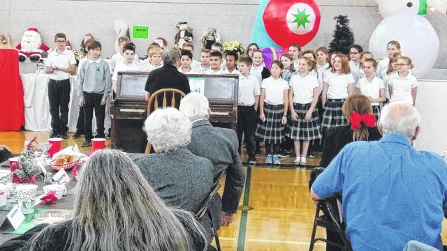 Submitted photos The 41st Annual Dr. Clement Austria Christmas Party was held Dec. 4 at St. Brigid Activity. Dr. Greg Austria and Steve Austria welcomed the seniors to the party and after lunch and a visit from Santa, performances were given by the third-sixth grade classes of St. Brigid. Following those performances, the seniors were entertained by the Xenia High School Ensemble with both music and dance. Mayor Marsha Bayless presented a proclamation to the 2017 Senior of the Year, Toni Charles. Charles was recognized for her hard work as the Ways and Means Committee chair and for the successful fundraising and volunteering she has accomplished during the year.