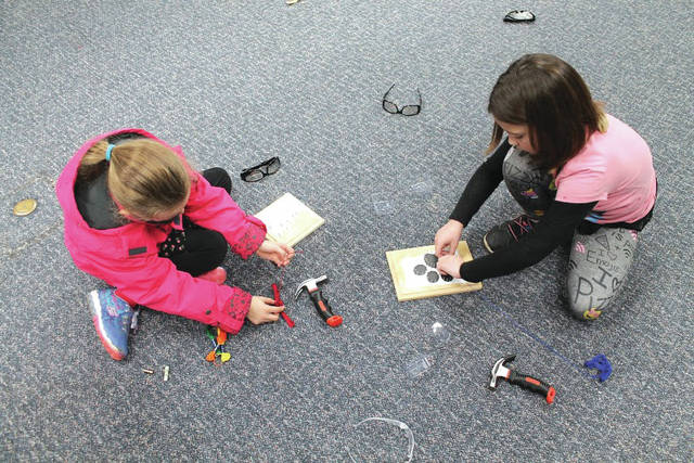 Anna Bolton   Xenia Gazette Greene County kids created string art Dec. 22 at Xenia Library using hammers, nails, wood, a template and string. Children worked with their parents and buddies during the afternoon craft activity, creating various shapes and images. The county's public library system hosts art activities, story times, movies and more throughout the week at its seven locations. A calendar of events can be found on its website.