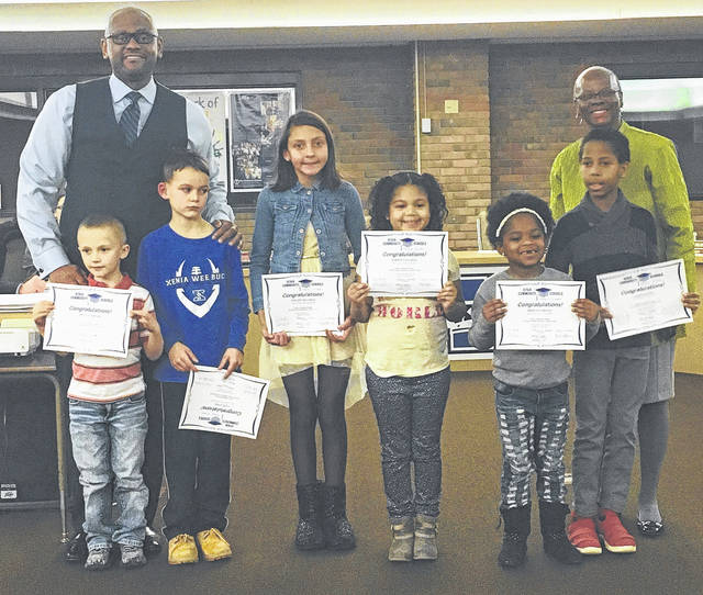 Submitted photo The Xenia Community School District Board of Education recognized December's Kids of Character at the Dec. 11 meeting. Pictured with Superintendent Dr. Gabe Lofton and board member Dr. Cheryl Marcus are: Owen Stidham (Xenia Preschool), Nate Long (Cox), Willow Heathco (Tecumseh), Karsyn Vaughan (McKinley), Krislynn Roney (Shawnee), and Jason Austin (Arrowood). Not pictured are Jada McAvene (Warner), and Camron Shanks (Xenia High School).