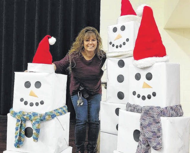 Submitted photo Julie Robbins with holiday decorations she put in the Cedar Cliff schools cafeteria.