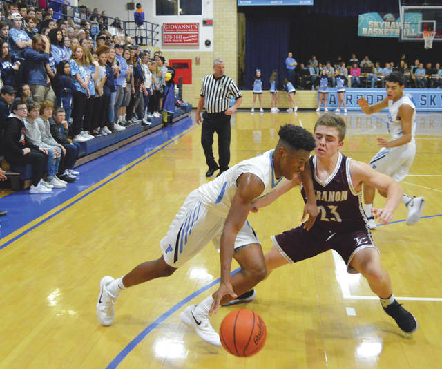 Shaunn Monroe, of Fairborn, drives the right baseline against Lebanon's Brendan Lamb, in the first half of Friday's Dec. 1 season opening high school boys basketball game at Baker Middle School in Fairborn. Monroe led the Skyhawks with 19 points, in the loss.